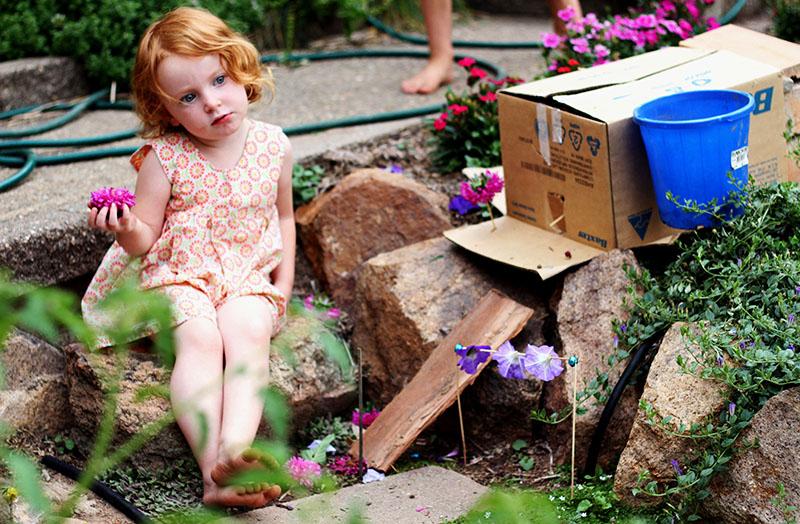 Q in fairy garden