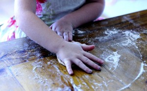 Child kneading bread dough